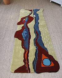 mustard rug with rust and blue horizontal waves