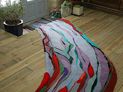 long curved runner rug in multi coloured lines and areas