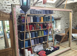 cones of wool on shelves